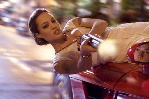 Ms. Jolie deals with some paparazzi on her way to adopt another child.